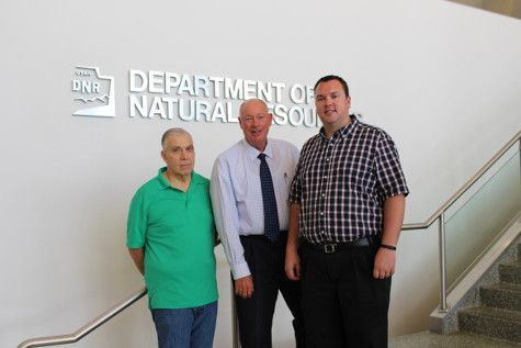 Lee Eschler and Aaron Austin with DNR Executive Director Mike Styler